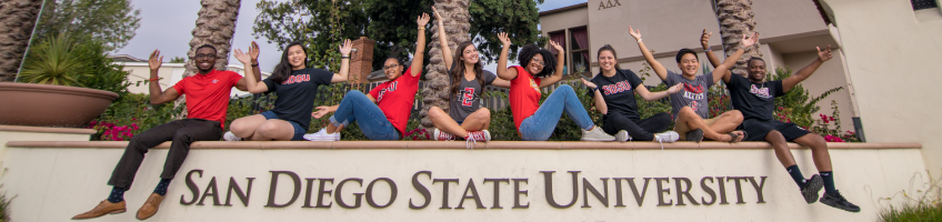 Happy students with the SDSU sign
